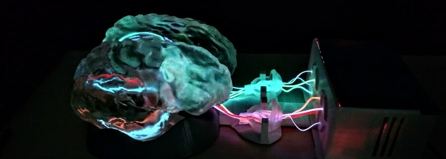 3D brain plugged into machine