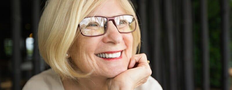Closeup of Happy Attractive Senior Woman in Cafe