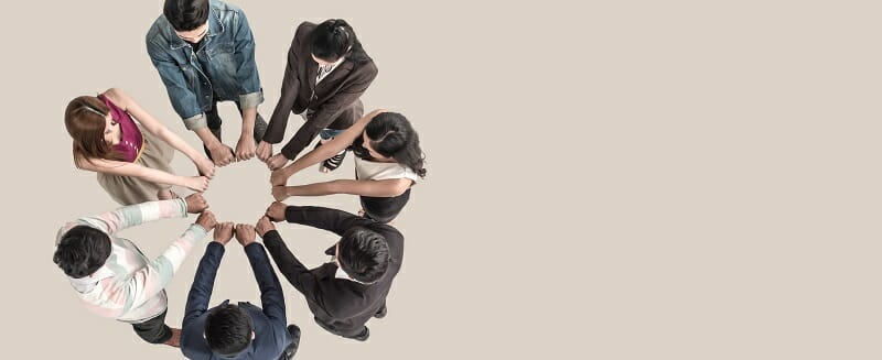 Top view of teen people in team fist bump assemble together.