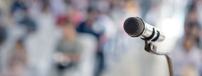 Microphone in front of a large audience