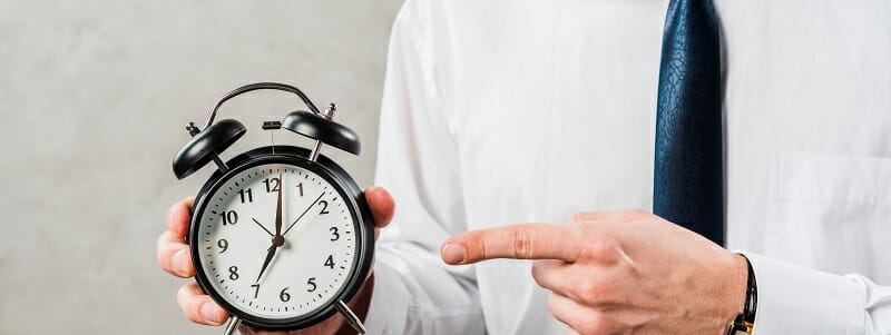 Man pointing to a clock